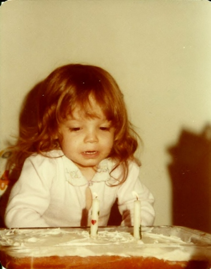 2nd birthday blowing out candles 3