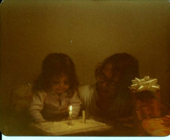2nd birthday blowing out candles 4