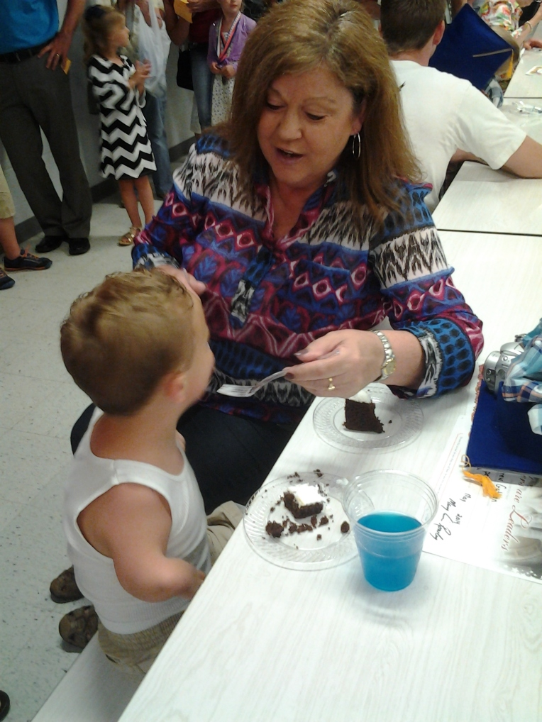 Drew eating his birthday cake with Ms. Karen